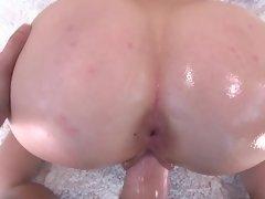 Big round ass cheeks coated in lube make fucking her fun