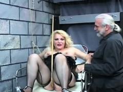 Bare woman bizarre bondage at home with lewd man