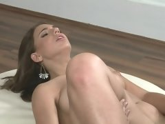 A brunette that has a lovely ass and a sweet pussy is sucking cock