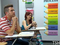 Redhead schoolgirl gets it on in an empty classroom with tatooed guy