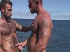 Muscle Daddies getting down and dirty by the Sea