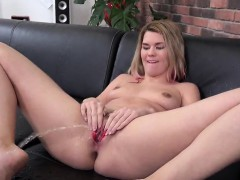 Breathtaking chick is pissing and pleasuring trimmed pussy