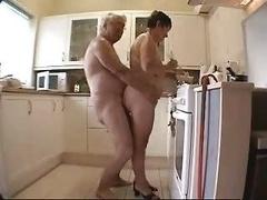 Grown-up Couple Having Fun In The Kit