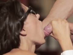 A girl that has her sexy glasses on is fucked hard in the office