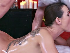 Inked brunette sucks and fucks masseur