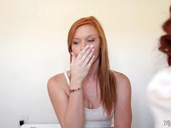 A redhead mom seduce a young hottie and lick her muff