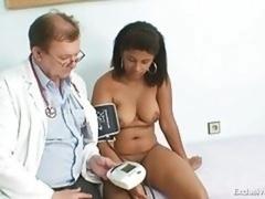 Black plumpish Manuela gyno exam by white grown-up doctor
