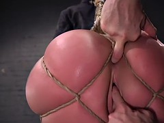 brunette with ass in bondage gets anal