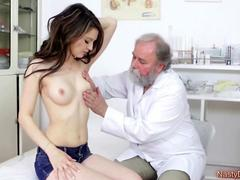 Teen Gets Examined By A Doctor