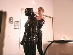 Rubber clad submissive feels the pain