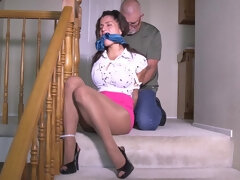 Mexican female of the building left hogtied and gagged with her huge boobs out.